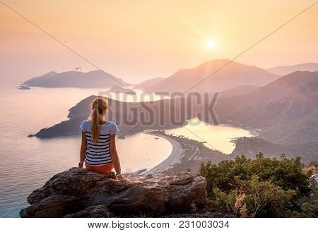 Landscape With Girl, Sea, Mountains And Orange Sky