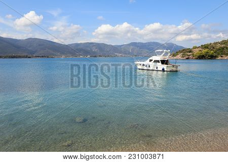 Summer Time A Beautiful Yacht Anchoring In Love Bay Poros Island Greece. Horizontal.