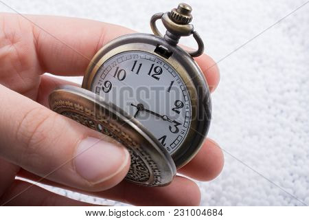 Retro Style Pocket Watch In Hand On White Background