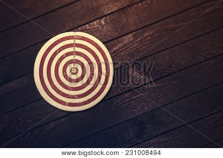 Dart Board On Dark Wooden Table. Business Concept.