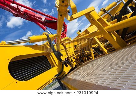 Concrete Pump Of Construction Machine, Heavy Industry Abstraction, Blue Sky And White Clouds On Back