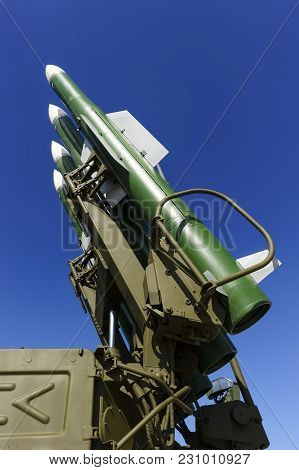 Ballistic Missile Launcher With Four Cruise Missiles On Powerful Mobile Transportation With Blue Sky