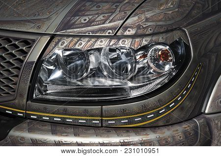 Car Headlight With Led And Xenon Lamps Of Modern Powerful Offroader Vehicle With Pattern On Grey Bod