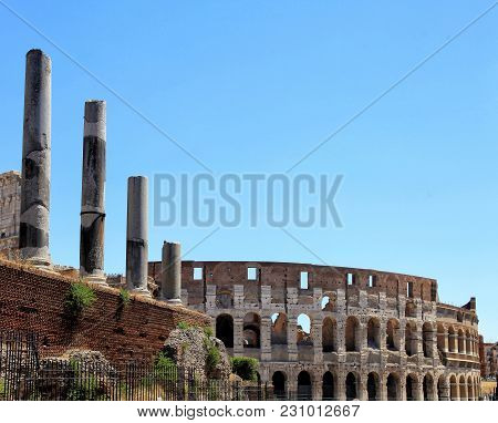 View With Ruins Of Great Stadium Colosseum And Columns Of Forum, Rome, Italy. Image With Copy Space