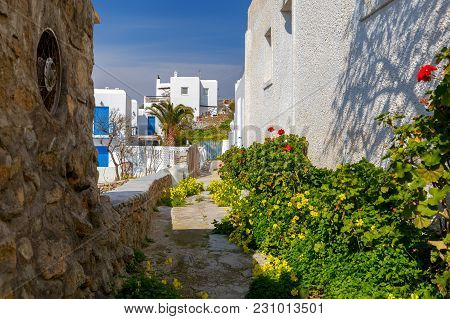 Narrow Traditional Street In The City Of Chora. The Island Of Mykonos. Greece.