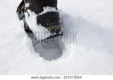 Footstep From Hiking Boot In A Fresh Snow