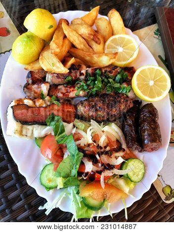 Plate Of Traditional Greek Meat Souvlaki With Potato And Salad, Delicious Plate Of Freshly Made Gree