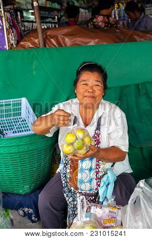 Chiang Mai, Thailand - August 24: Woman Sells Fruits At The Market On August 24, 2016 In Chiang Mai,