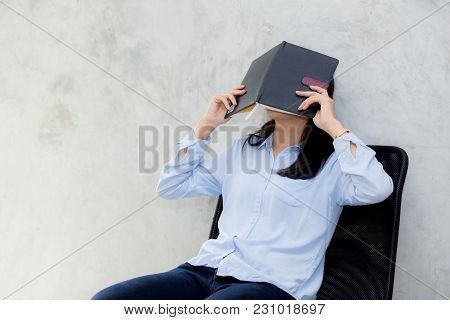Close Up Of Young Asian Woman Reading Book And Hiding Face On Cement Background, Girl Leisure With A