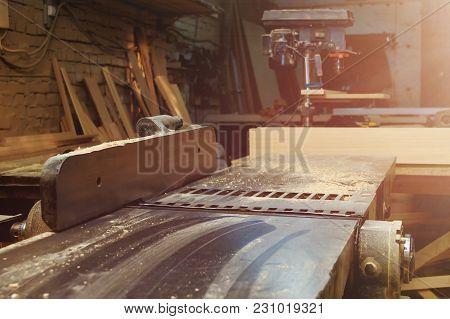 Woodworking Plane Machine In Carpentry Workshop. Machine Tool In Factory