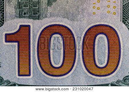 Closeup Of The 100 On The Reverse Of A One Hundred Dollar Bill For Background Iii