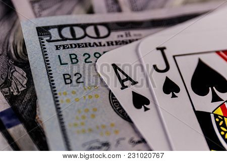 Closeup Of A Blackjack 21 Hand On A Bed Of One Hundred Dollar Bills (shallow) Ii