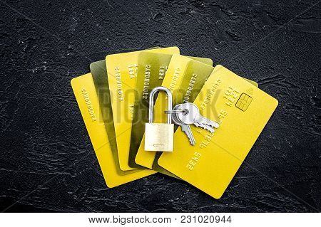 Electronic Payments Protection. Bank Cards Near Lock And Keys On Black Background Top View.