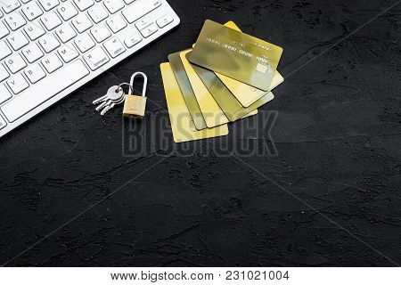 Secure Payments. Bank Cards Near Lock And Keys And Keyboard Of Computer On Black Background Top View