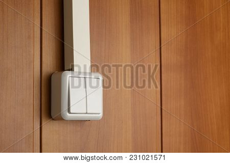 Two-column Wall Switch Attached To Wooden Wall And With Cable-channel Hidden Power Cable