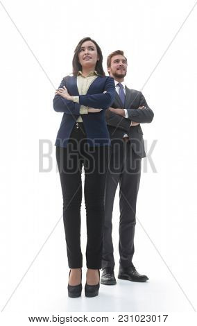 Two confident smiling businesspeople in formalwear isolated
