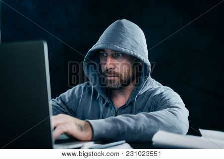 Mysterious Bearded Man Hacks A Laptop, In A Hood, In The Dark