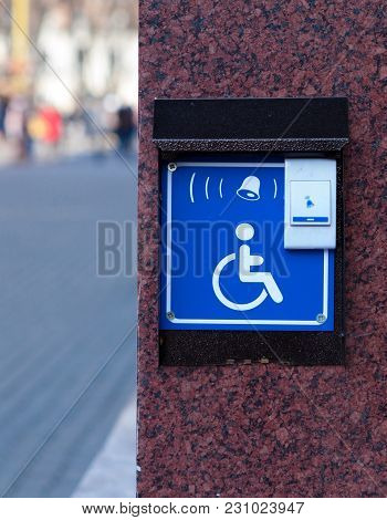 Handicapped Access Entrance Pad Mounted To A Wall. Sign A Button For A Visa For People With Disabili