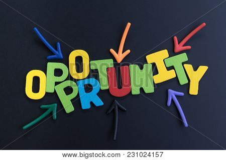 Colorful Arrows Pointing To The Word Opportunity At The Center On Black Chalkboard, Concept Of Futur