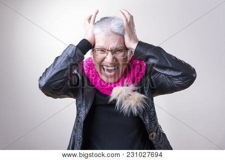 Senior Elder Woman Screaming With Rage And Frustration, Studio Image, White Background