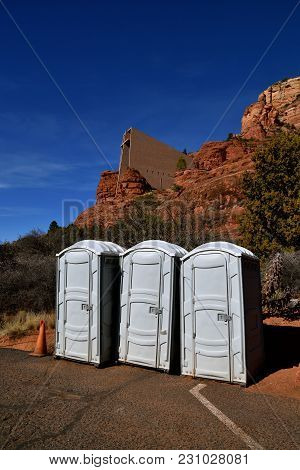 Three Portable Bathrooms Are Located In Front Of The Famous Chapel Of The Cross In In Sedona, Arizon