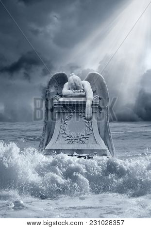 A Grieving Angel Statue Being Hit With Crashing Waves, As A Premade Background.