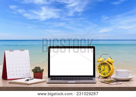 Modern Laptop Computer, Coffee Cup, Alarm Clock, Notebook And Calendar On Wooden Table And View Of T