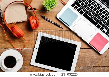 Office Desk Table With Laptop,smart Phone,pen,headphone,tablet,notebook And Cup Of Coffee.flat Lay P