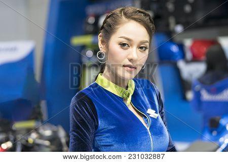 Bangkok-thailand-3 December 2017: An Unidentified Female Presenter Models At Suzuki Motorbike Booth