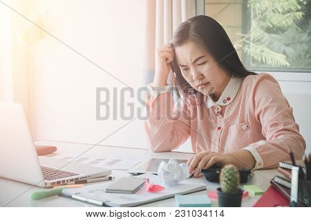 Sad Business Woman Sitting In Office With Her Financial Data.stressful For Work.