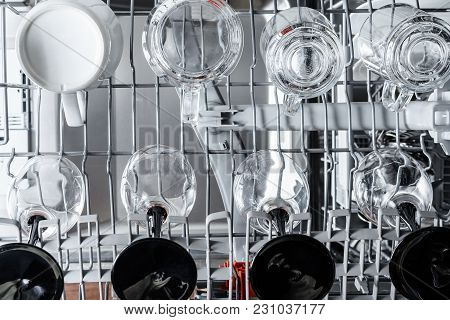 Dishes Of Glasses And Cups In The Dishwasher Are Ready For Washing. Top View