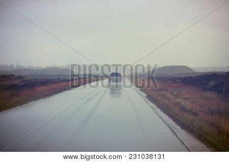 Misty road in rainy weather