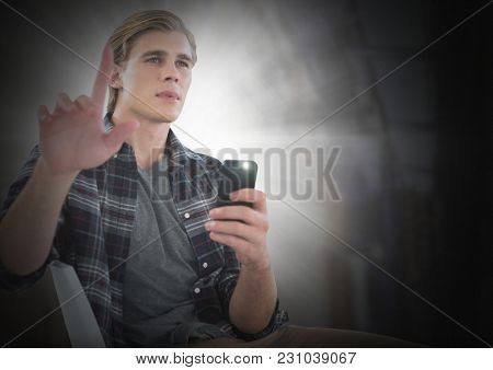 Digital composite of Businessman touching air glow holding phone