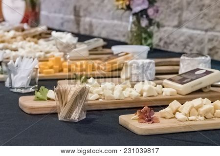 Cheese Samples Laid Out On Display Boards At A Local Creamery In Wisconsin