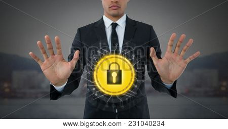 Digital composite of Businessman holding security lock icon