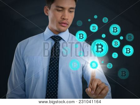 Digital composite of Businessman touching bit coin graphic icons