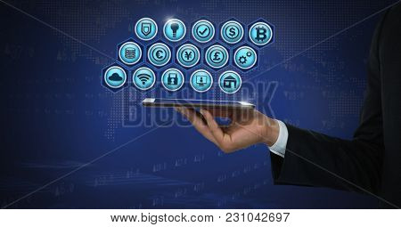 Digital composite of Business icons and hand holding tablet