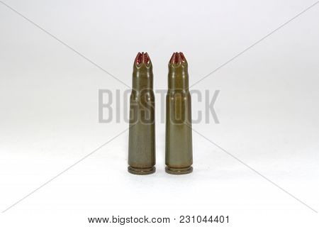 Two Blank Cartridges For A Kalashnikov Assault Rifle On White Background Close-up
