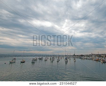 Cumulus Overcast Sunrise over Newport Beach Harbor in southern California United States poster