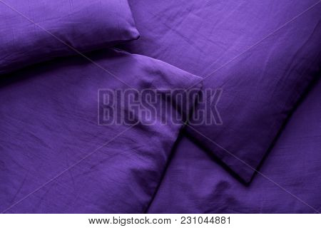 Ultra violet background. Abstract fabric texture of a saturated purple color