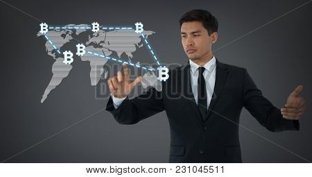Digital composite of Businessman touching bit coin graphic icons on world map