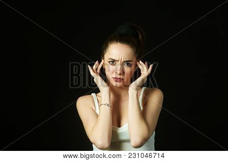 The Girl Suffers From A Headache .stress And Fatigue