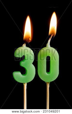 Burning Candles In The Form Of Thirty Figures (numbers, Dates) For Cake Isolated On Black Background
