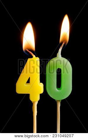 Burning Candles In The Form Of Forty Figures (numbers, Dates) For Cake Isolated On Black Background.