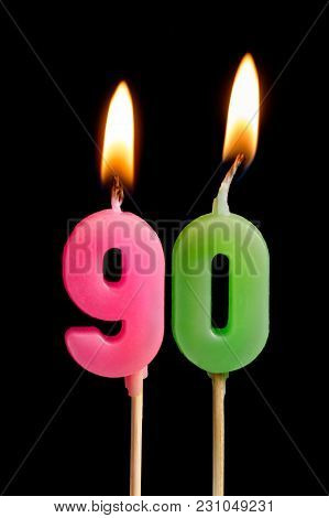 Burning Candles In The Form Of Ninety Figures (numbers, Dates) For Cake Isolated On Black Background