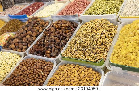 Ingredients For Healthy Vegetarian Food Are Nuts And Dried Fruits On Trays. Walnut, Pecans, Almonds,