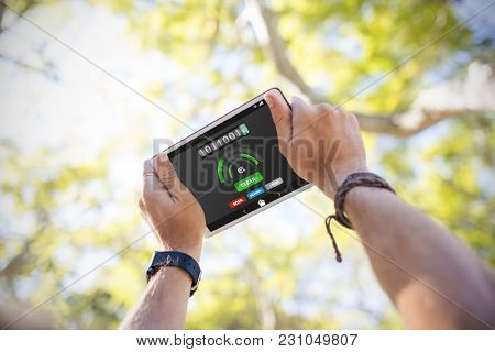 Mobile display with memory cleaner against cropped hands using digital tablet