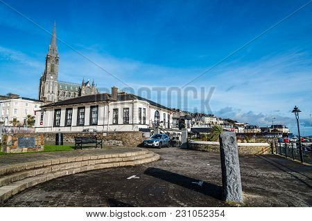 Cobh, Ireland - November 9, 2017: Waterfront And Promendade In Cobh With St. Colman Cathedral On Bac