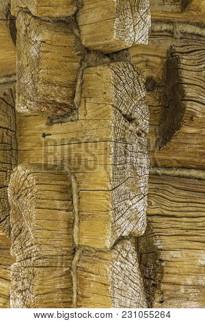 Detail Of A Wooden Refurbished Barn. Built In The 18th Century. Angle Joint Of Logs. Interesting Pho