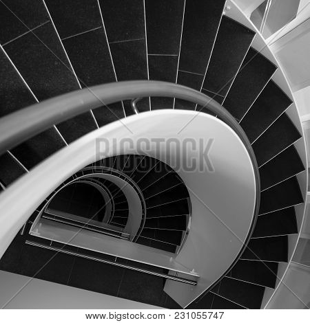 Spiral Staircase In A Modern Building In Black And White